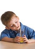Llittle boy drinking juice Stock Photos
