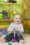 Llittle boy at play in his room Stock Photography