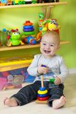 Llittle boy at play in his room Royalty Free Stock Photo