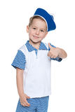 Llittle cheerful boy in a sailor suit Royalty Free Stock Photo