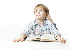Llittle child reading book and dreaming stock image