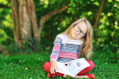 Llittle girl with a book Stock Image