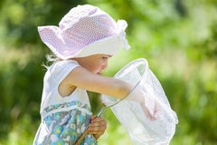 Llittle girl with butterfly net Stock Photography