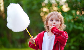 Llittle girl eating cotton candy Royalty Free Stock Image