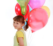 Llittle girl holding colorful balloons Royalty Free Stock Photos