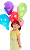 Llittle girl holding colorful balloons Stock Image