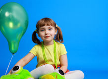 Llittle girl holding colorful balloons Stock Photo