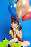 Llittle girl holding colorful balloons Stock Photography