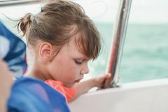 Llittle girl in life-jacket as passenger of boat Royalty Free Stock Images