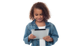 Llittle girl looking digital tablet Royalty Free Stock Photo
