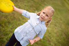 Llittle girl play frisby Stock Image