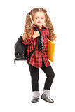 Llittle girl standing with backpack and book Royalty Free Stock Images
