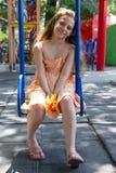 Llittle girl swinging on the playground Royalty Free Stock Image