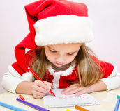 Llittle girl writes letter to Santa Stock Image