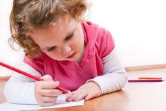 Llittle Mädchenzeichnung um ihre Hand Lizenzfreie Stockbilder