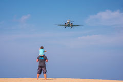 Llooking the plane. Royalty Free Stock Photo