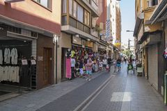 Turistic Street along sea beach with little shops and cafe in Lloret De Mar, Catalonia. LLORET DE MAR, CATALONIA - SEPTEMBER 2016; Tiuristic Street along sea royalty free stock image