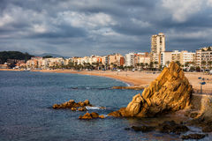 Lloret de Mar on Costa Brava in Spain. Lloret de Mar, coastal resort town on Costa Brava in Spain, beach and town skyline at Mediterranean Sea Balearic Stock Photo