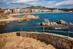 Lloret de Mar Resort Town on Costa Brava in Spain. Lloret de Mar resort town skyline on Costa Brava in Spain, stairs to the sea stock image