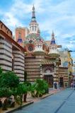 Church of Sant Roma, Lloret de Mar, Costa Brava, Spain. LLORET DE MAR, SPAIN - SEPTEMBER 10, 2018: Unidentified people walk down street near Church of Sant Roma stock photography