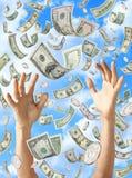 Llover las manos del dinero que cogen dólares Fotos de archivo libres de regalías