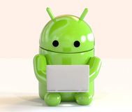 Google Android OS logo mascot working on a laptop  on white background Royalty Free Stock Images
