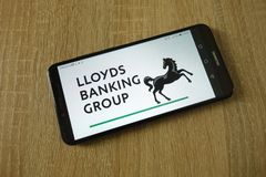 Lloyds Banking Group plc logo displayed on smartphone. KONSKIE, POLAND - March 16, 2019: Lloyds Banking Group plc logo displayed on smartphone royalty free stock photos