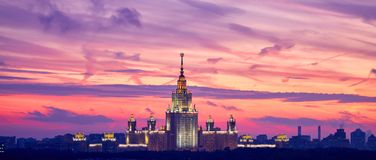 Lluminated silhouette of famous Russian university on the dramat stock photos