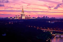 Lluminated silhouette of famous Russian university on the dramat stock image