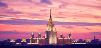 Lluminated silhouette of famous Russian university on the dramat royalty free stock photo