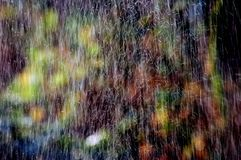Lluvia del color Fotos de archivo