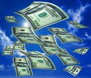 Lluvia del dinero en el cielo Imágenes de archivo libres de regalías