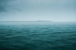 Lluvia en el agua Imagen de archivo libre de regalías