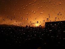 Lluvioso la puesta del sol Foto de archivo