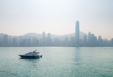 Lluxury speedboat with the city's famous skyline in the distant, Royalty Free Stock Image