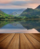Llyn Nantlle at sunrise looking towards mist shrouded Mount Snow Stock Images