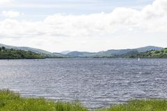 Llyn Tegid Bala Lake with mountains in the background. Llyn Tegid Bala Lake is formed by a glacial valley and is the largest in Wales Stock Image