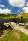Llyn y Dywarchen Reservoir with two rowing boats by jetty, Snowd Royalty Free Stock Photo