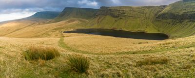 Llyn y Fan Fach and Picws Du, Wales, UK. Dark clouds over Llyn y Fan Fach and Picws Du Bannau Sir Gaer in the Carmarthen Fans, Carmarthenshire, Wales, UK Stock Photography