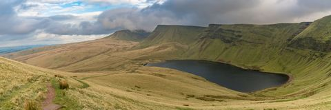 Llyn y Fan Fach and Picws Du, Wales, UK. Dark clouds over Llyn y Fan Fach and Picws Du Bannau Sir Gaer in the Carmarthen Fans, Carmarthenshire, Wales, UK Royalty Free Stock Image