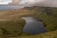 Llyn y Fan Fach and Picws Du, Wales, UK. Dark clouds over Llyn y Fan Fach and Picws Du Bannau Sir Gaer in the Carmarthen Fans, Carmarthenshire, Wales, UK Royalty Free Stock Photo