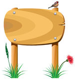 Éléments en bois et un oiseau Images stock