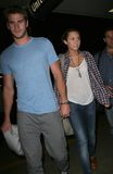 LMiley Cyrus & boyfriend Liam Hemsworth at LAX Stock Images