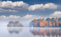LMisty autumn morning on the city pond. Royalty Free Stock Photography