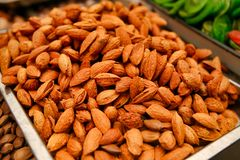 Unpeeled almond lie on the counter close-up. stock photo