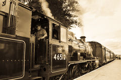 LMS 46512 steam train stopped in station Royalty Free Stock Photos
