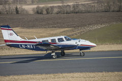 Piper PA-34-200T Seneca II, LN-MAT. The aircraft Piper PA-34-200T Seneca II, LN-MAT gives full throttle on both engines for take off. Image is shot at Rakkestad Stock Image