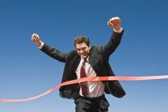 Línea de Crossing The Finish del hombre de negocios Fotografía de archivo libre de regalías