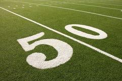 Línea de yardas americana del campo de fútbol 50 Fotografía de archivo libre de regalías