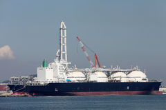 LNG cargo ship. Docked in the port Stock Image